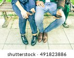 young couple holding phone... | Shutterstock . vector #491823886
