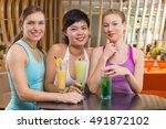 three young women drinking... | Shutterstock . vector #491872102