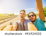 happy friends taking selfie at... | Shutterstock . vector #491924332
