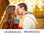woman and man kissing in park... | Shutterstock . vector #491941576
