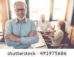 handsome mature businessman in... | Shutterstock . vector #491975686