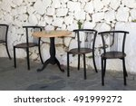 Old Chairs And White Stone...