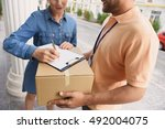 courier making delivery to...   Shutterstock . vector #492004075