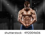 sexy muscular man posing in gym ... | Shutterstock . vector #492004606