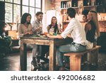 dinner party. group of cheerful ... | Shutterstock . vector #492006682