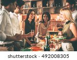 enjoying home party. group of... | Shutterstock . vector #492008305