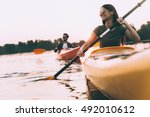 enjoying nice time on river... | Shutterstock . vector #492010612