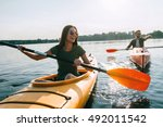couple kayaking together.... | Shutterstock . vector #492011542