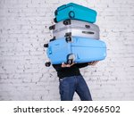 man holding three heavy...   Shutterstock . vector #492066502