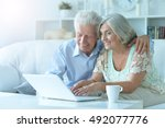 senior couple  with laptop | Shutterstock . vector #492077776