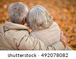 mature couple in the autumn park | Shutterstock . vector #492078082