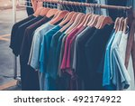t shirt many color on rack.... | Shutterstock . vector #492174922