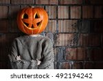 Stock photo pumpkin head monster sign hand space halloween 492194242