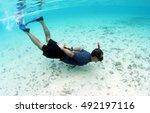 freediver asian man in blue... | Shutterstock . vector #492197116