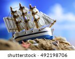 Sand Shell And Sail In Sea