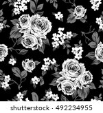 Stock vector seamless vector vintage pattern with victorian bouquet of white flowers on a black background 492234955