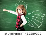 superhero school child in class.... | Shutterstock . vector #492289372