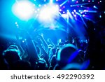 crowd raising hands and... | Shutterstock . vector #492290392
