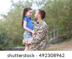 Us Army Soldier With Little...