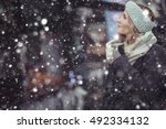 girl on a winter walk in the... | Shutterstock . vector #492334132