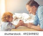handsome grandpa and grandson... | Shutterstock . vector #492349852