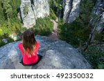 young woman sitting in... | Shutterstock . vector #492350032