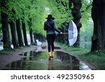 Feet In Rubber Boots Rain...