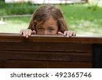 Kid Hiding Behind A Bench....