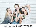 three female friends posing in... | Shutterstock . vector #492373858