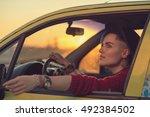 creative person portrait in car | Shutterstock . vector #492384502