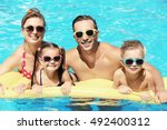 happy family in swimming pool... | Shutterstock . vector #492400312