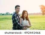 a pair of lovers in the meadow... | Shutterstock . vector #492441466