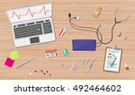 wooden doctors desk with laptop ... | Shutterstock .eps vector #492464602