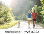 senior couple with dog running... | Shutterstock . vector #492516322