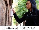 Afro American Woman Using Spra...