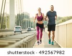 happy couple running over the... | Shutterstock . vector #492567982