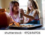 mother and daughter preparing... | Shutterstock . vector #492646936