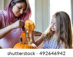 mother and daughter carving a... | Shutterstock . vector #492646942