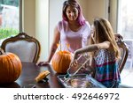 mother and daughter carving a... | Shutterstock . vector #492646972