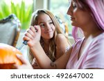 mother and daughter carving... | Shutterstock . vector #492647002