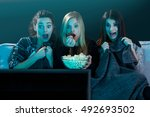 teenage girls watching horror... | Shutterstock . vector #492693502