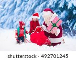 santa claus and children... | Shutterstock . vector #492701245