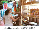 woman in colourful souvenir... | Shutterstock . vector #492719002