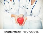 two woman doctor holding a red... | Shutterstock . vector #492723946