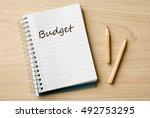budget on notebook on desk | Shutterstock . vector #492753295