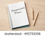 financial plan on notebook on... | Shutterstock . vector #492753358