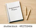 insurance plan on notebook on...   Shutterstock . vector #492753406