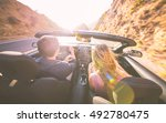couple driving fast on a sport... | Shutterstock . vector #492780475