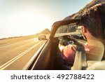 cool man driving a sport... | Shutterstock . vector #492788422