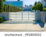 modern gates with driveway to... | Shutterstock . vector #492803032